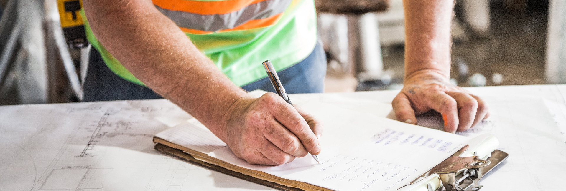 Construction manager looking at training checklist