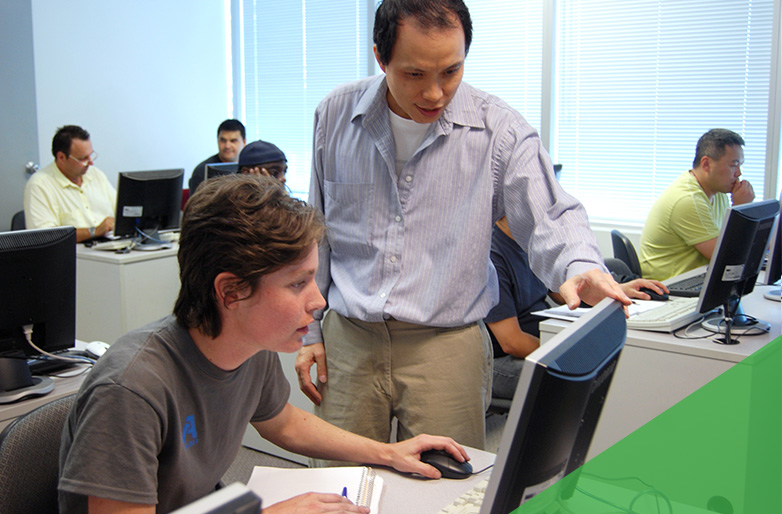 One of our industry-professional instructors lending a hand to a student in class.