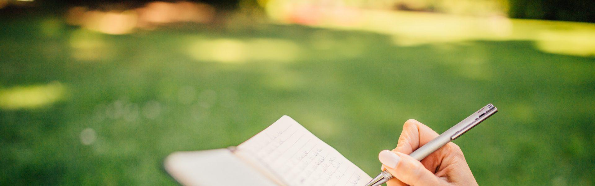 woman writing SMARTER goals