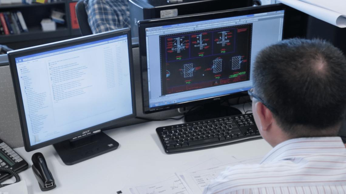 Drafting Technician on computer.